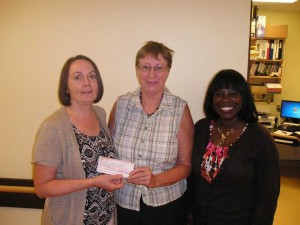 Pinawa Foundation Board Member Carol Findlay presents a Foundation Grant to Survivor's Hope Crisis Centre Inc. Chairman Connie Holmlund and Holly Parcey, Executive Director.