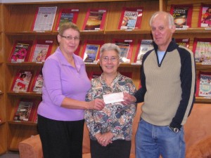 Pinawa Foundation Board Member Carol Findlay presents a Foundation Grant to Pinawa Public Library Chair Mike Luke and Marg Stokes, Librarian
