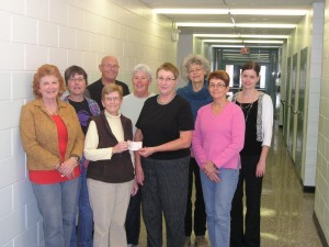 C. Findlay presents a Foundation Grant to Friends of the Ironwood Trail members